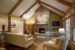 Vaulted Ceiling In Living Room With Fireplace Stock Photo