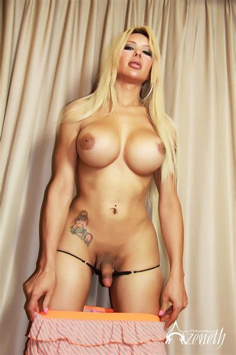 A Busty Blonde Shemale Teases With Her Huge Cock