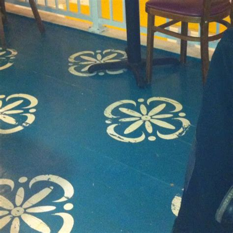 We have two locations in hamilton, oh. painted wooden floors at the local coffee shop (True West in Hamilton, Ohio) great way to cover ...