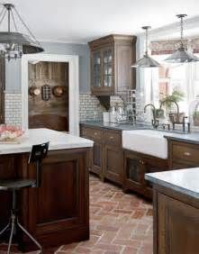 kitchen cabinets white subway tile blue gray walls brick floor halooga
