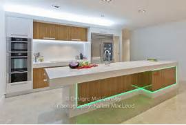 Lights Add Interest To A Rather Minimalist Kitchen In Wood And White Designed By Form Studio Interior Design By Elizabeth Bowman Modern Minimalist Kitchen Design By Comprex Contemporary Minimalist 15 Simple And Minimalist Kitchen Space Designs Home Design Lover