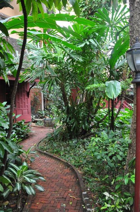 jim gardening garden at jim thompson house photo