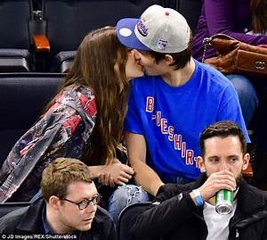 Ansel Elgort kisses Violetta Komyshan at hockey game ...