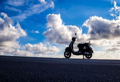 Vespa With Sky Blue Wallpaper by Parked Vespa Picography Free Photo