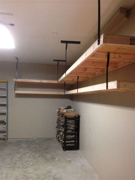 Garage Shelving Hanging by Garage Shelves Using 2x4s Plywood And Wrought Iron