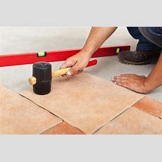 Installing Ceramic Flooring  Fitting A Tile Stock Image