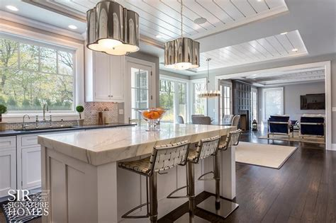 KItchen Island with White Woven Leather Counter Stools and