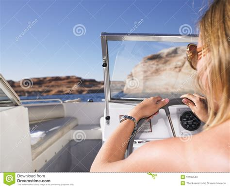 Driving Boat In Dream by Woman Driving Boat Stock Photos Image 12597543