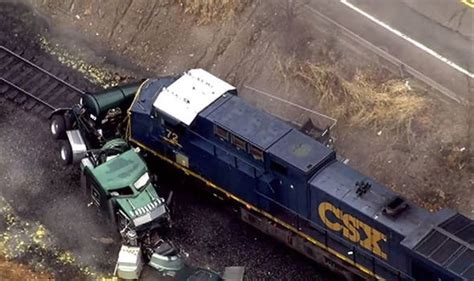 Truck Carrying Acid Hit By Train