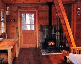 small log home interiors pics photos cabin interior with a small table and chipped chairs