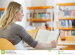 Young Woman Reading Book In Library Stock Image - Image ...