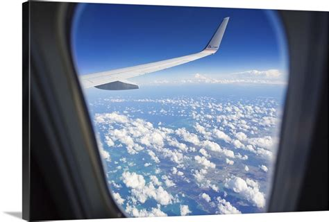 View Through A Passenger Airplane Window Flying Over The