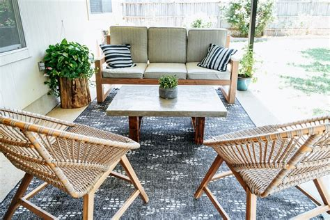 90% of the time the cushions are stored in the table. DIY Concrete Outdoor Coffee Table - Love & Renovations