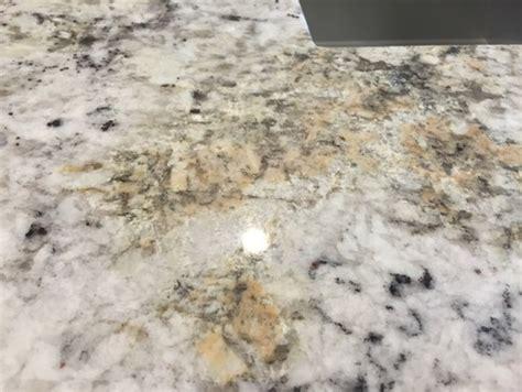 white granite has rust stains