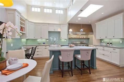 white cabinets teal island turquoise backsplash