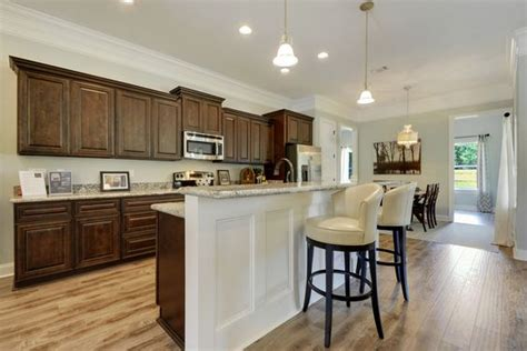 wainscoting kitchen island large galley kitchen with chocolate cabinets and