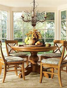 a round dining table with a bountiful centerpiece With round dining room table centerpieces