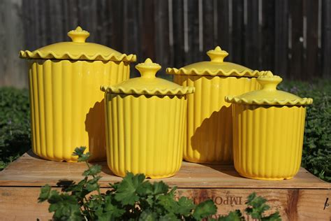 cheery yellow ceramic kitchen canisters set
