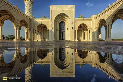 zulfa mosque reflection  water follow   facebook