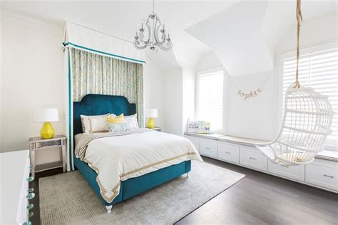 White And Blue Teen Girl Bedroom With Curtains Behind Bed