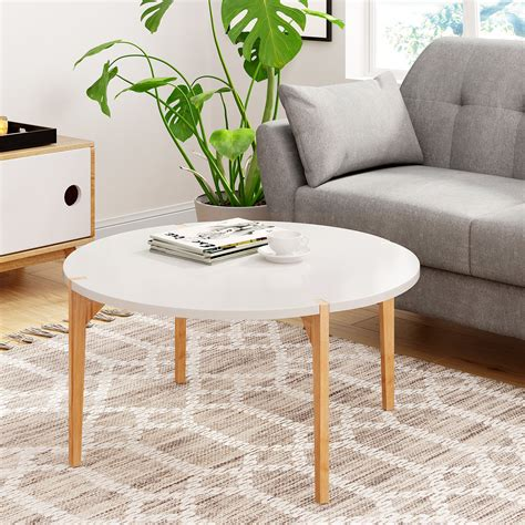 Made from solid and engineered wood in a walnut finish, this table has tapered legs and clean lines for that classic silhouette. Universal Expert Abacus Round Coffee Table, Mid Century ...