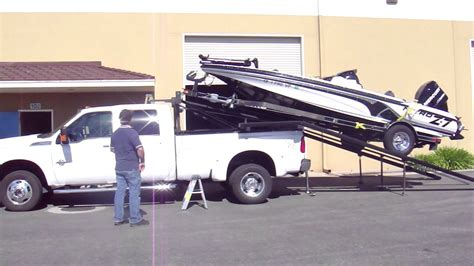 Truck Bed Boat Carrier by Boat Loading On Top Of Truck Mp4