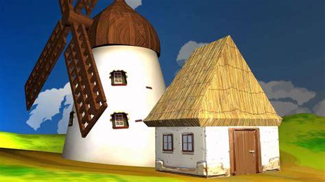 A Windmill And Small Cartoon Like House