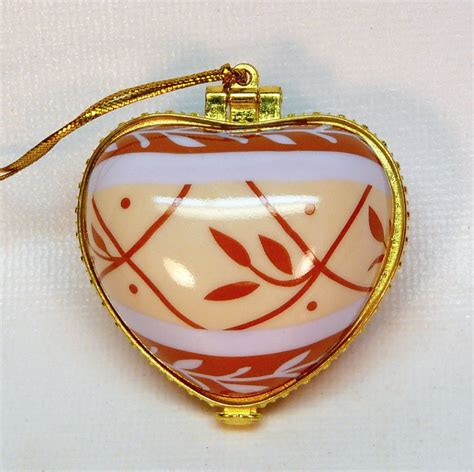 porcelain hinged heart shaped christmas ornament laughter