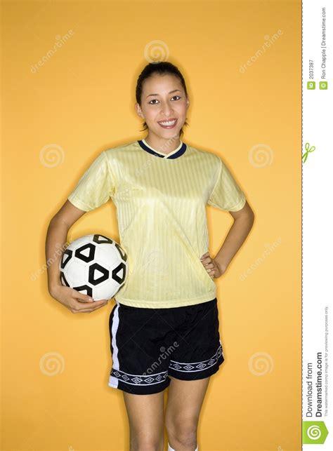 multi racial teen girl holding soccer ball royalty