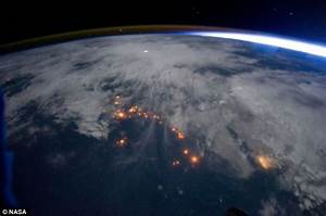 Striking images of lightning storms raining down on Earth ...