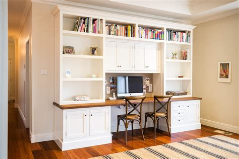 desk with bookshelves above home office traditional with