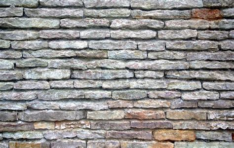 Texture Of Wall Made Of Old Grey Bricks Like Stone