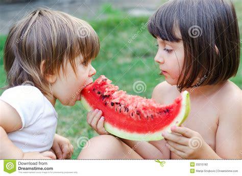 Children Sharing Watermelon Stock Photography