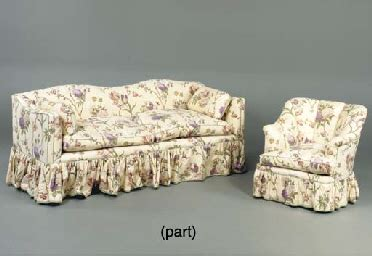 a chintz upholstered sofa and four chairs en suite