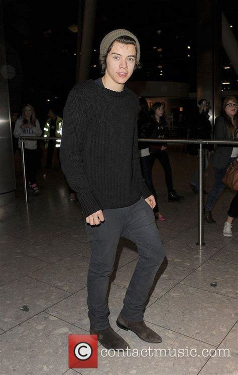 Harry Styles One Direction Arrive Heathrow Airport
