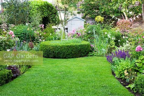 gap gardens small cottage garden with buxus circle and