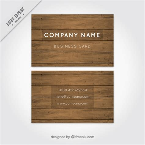 Business card with white letters and wooden background