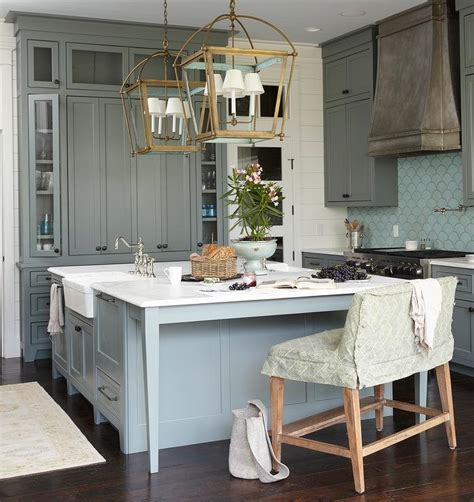 green kitchen cabinets with blue fan tile backsplash cottage kitchen sherwin williams retreat