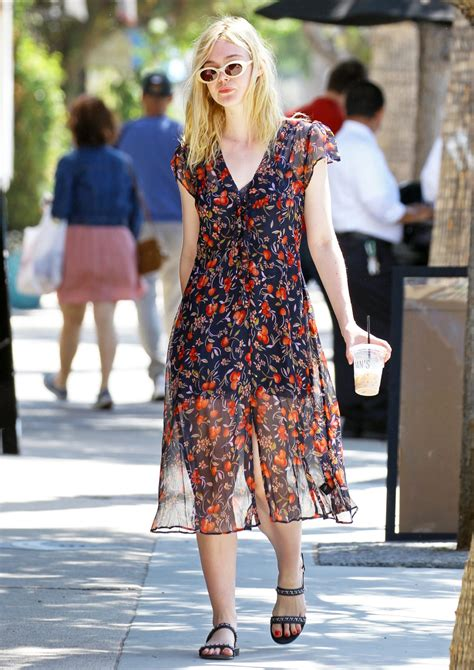 elle fannings retro street style   cherry print dress instylecom