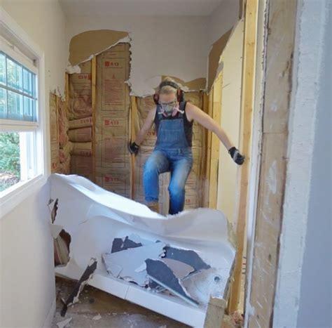 bathroom demolition sawdust girl