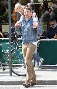 Ethan Hawke horses around with his daughter as they stroll ...