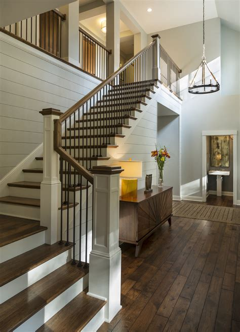 siege social casa entryway with rustic wood floors l shaped stairway