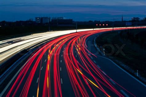 Many Cars Are Driving At Night On A Highway And Create