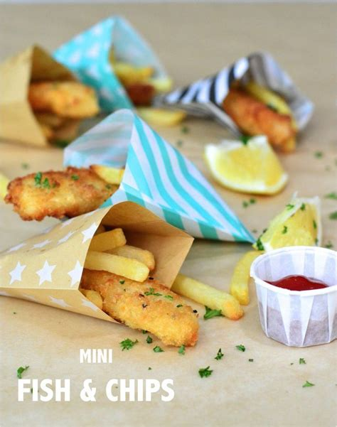 mini fish chips served  colourful paper party bags