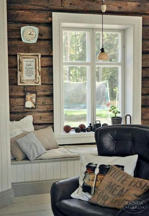 stained wood walls  white trim  floors   log