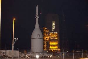 NASA's Pathfinding Orion Rolls to Launch Pad, Hoisted atop ...