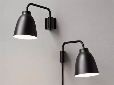 buy the lightyears caravaggio read wall light at nest co uk