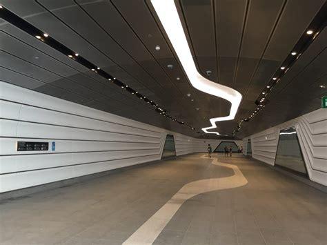 wynyard  barangaroo walkway tunnel custom perforated metal panels arrow metal