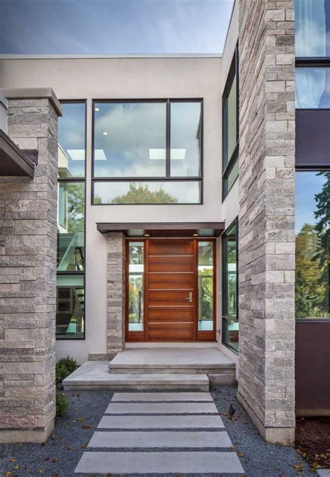 modern house front view  stucco  stone exterior house front house architecture design