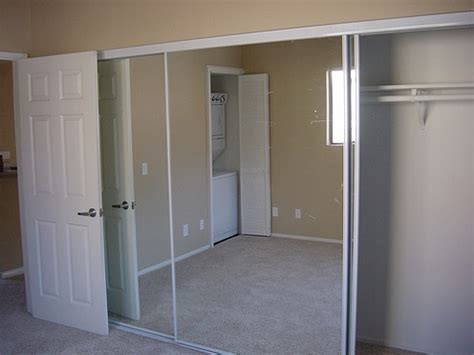 sliding mirror closet door floor track ideas advices